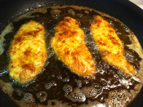 fry breaded chicken in hot oil