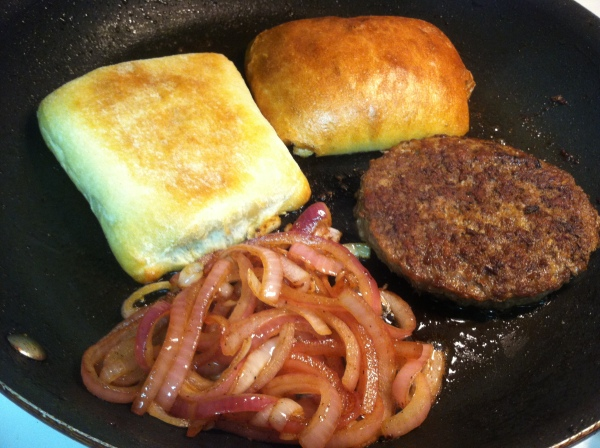 burger, caramelized onion and toasted ciabatta bread