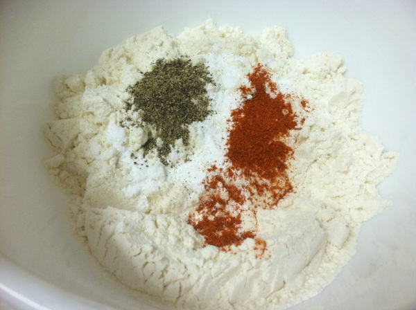 Mix flour with cayenne and ground black pepper.
