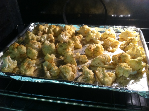 cauliflower roasting in the preheated oven at 425°F for 40 - 45 minutes.