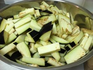 Slice eggplants into thin strips.
